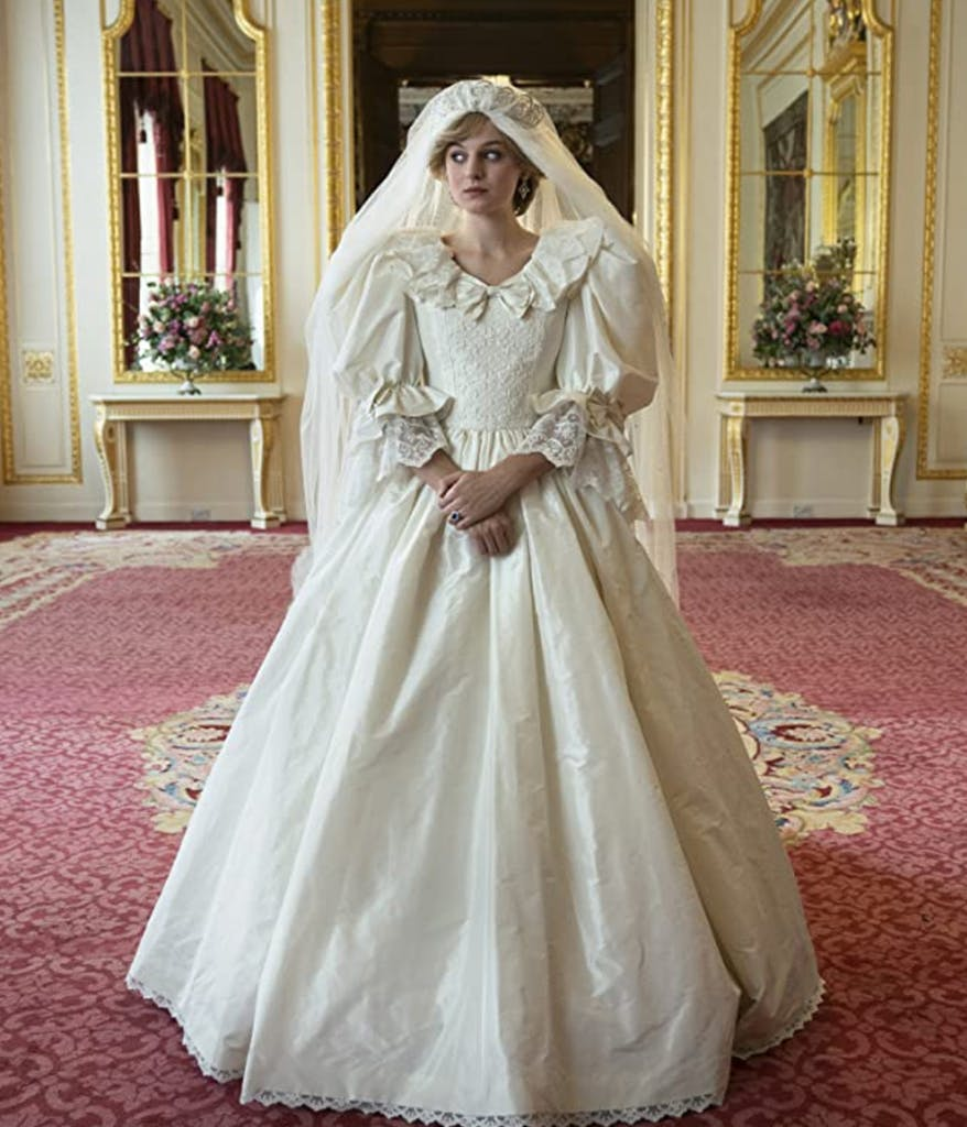 Photo of the actress playing Princess Diana on The Crown wearing a wedding dress