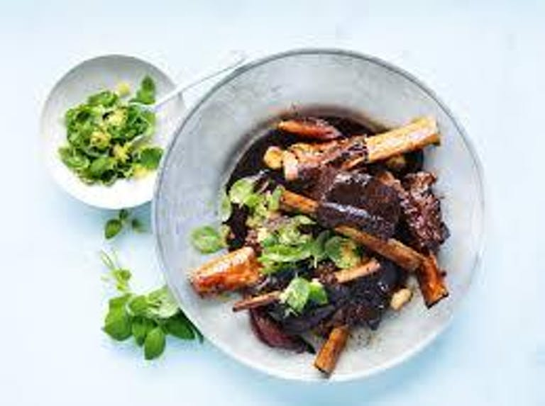 Slow Roasted Short Ribs with North Fork Red Onion & Lemon Basil Gremolata (4 Ribs) by Art of Eating Catering | PartySlate