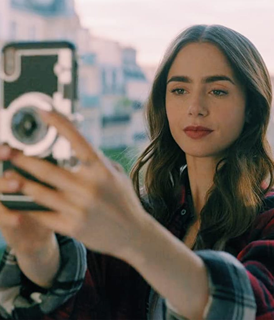 Emily Cooper from Emily in Paris taking a selfie