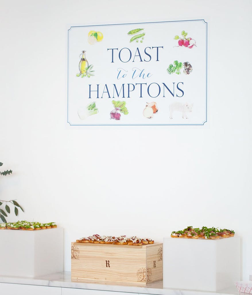 toast to the hamptons signage above toast snacks at a hamtpons-themed party