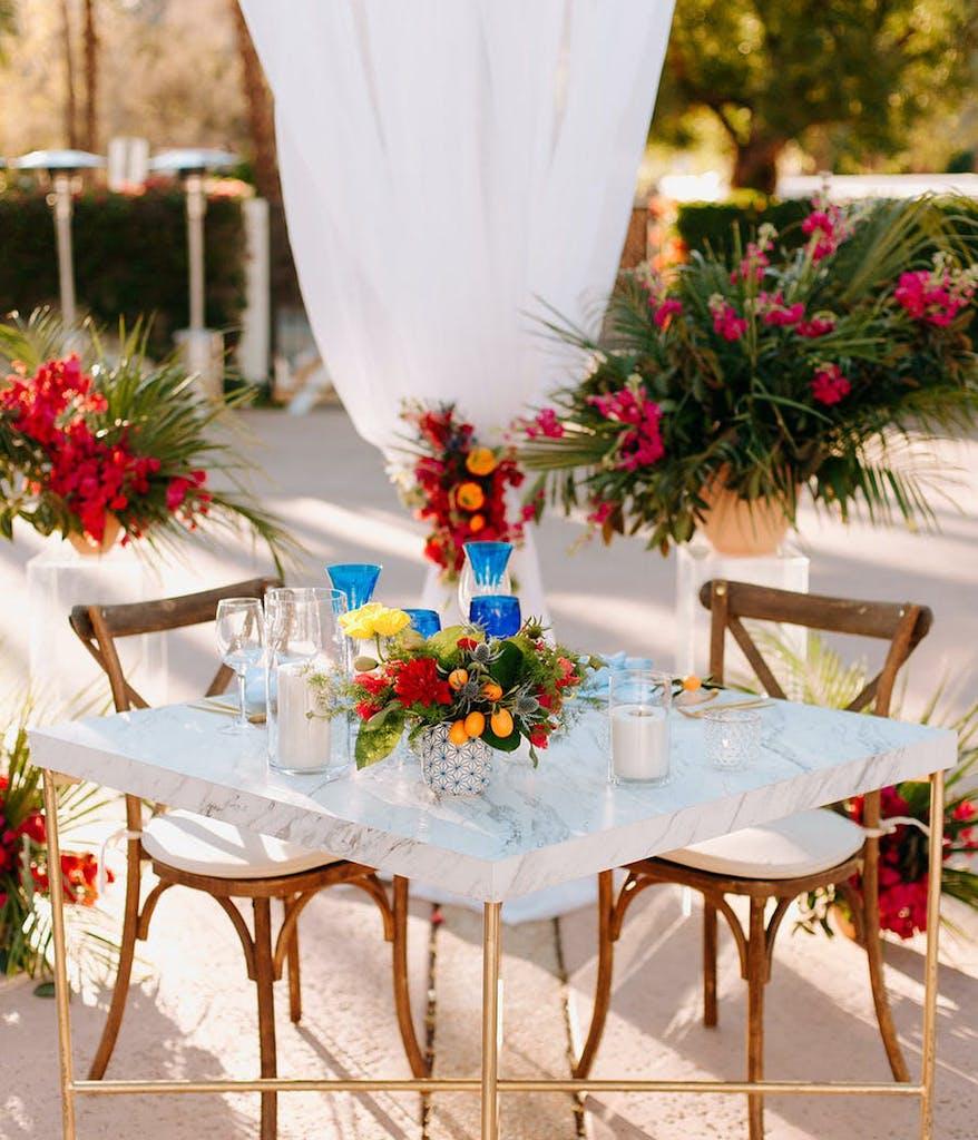 sweetheart table at a tropical wedding at La Quinta Resort & Club