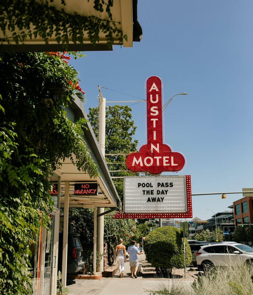 Photo of an Austin motel with a sign for a pool party