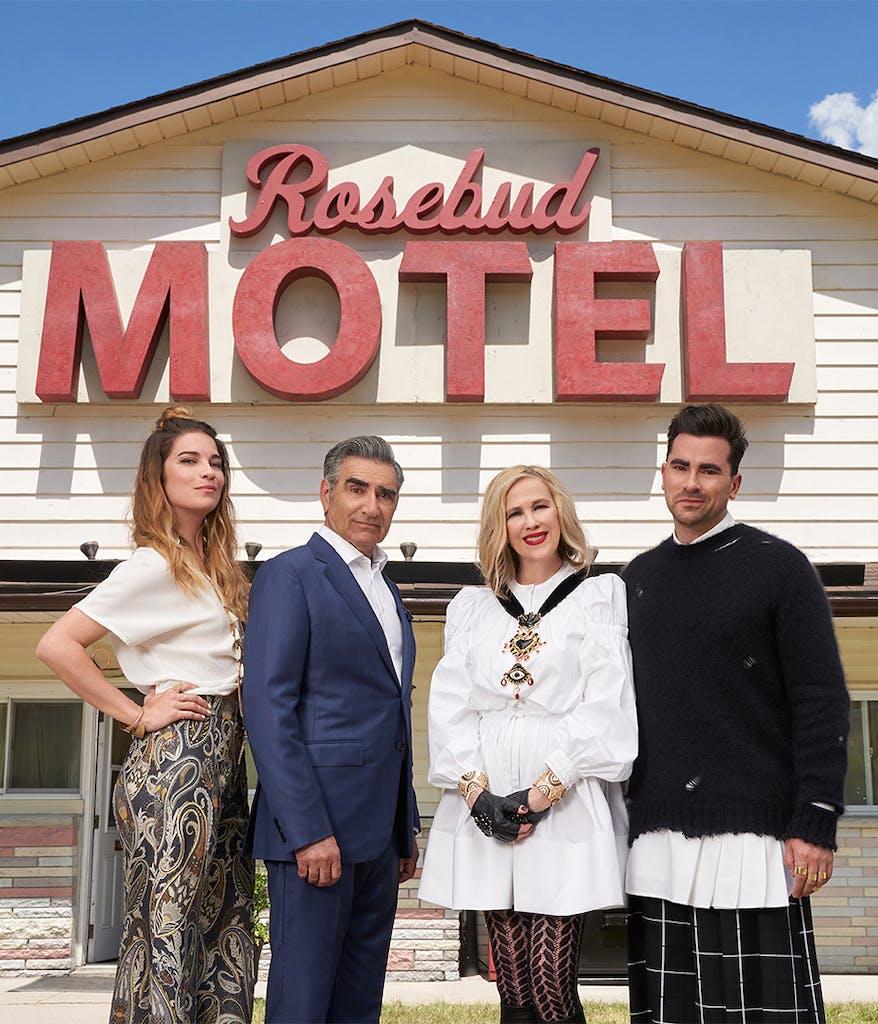 Cast members of Schitt's Creek in front of the Rosebud Motel