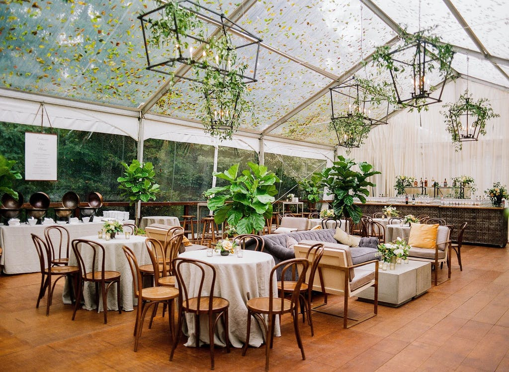 Clear Wedding Tent With Covering of Autumn Leaves | PartySlate