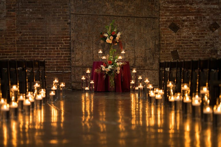 Beautiful candlelight wedding aisle for a micro wedding   PartySlate