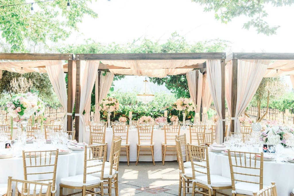 Wedding Cabana Tent With Blush Drapery in Garden Setting | PartySlate