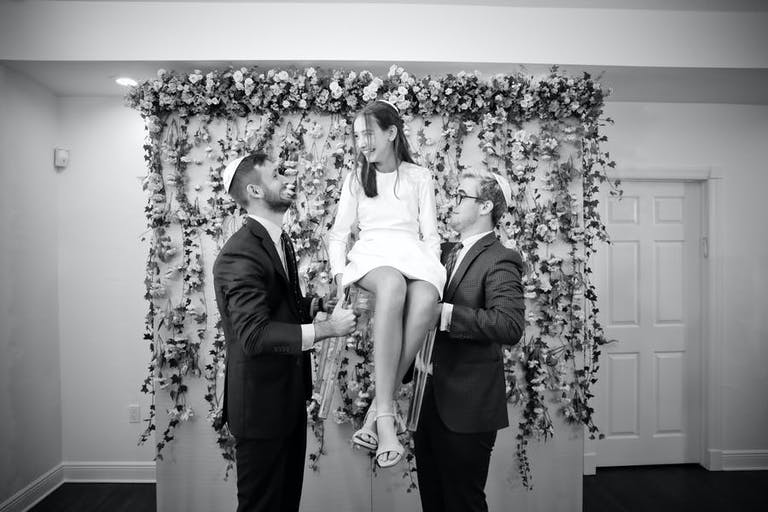 A at-home Bat Mitzvah moment of being lifted in a chair | PartySlate