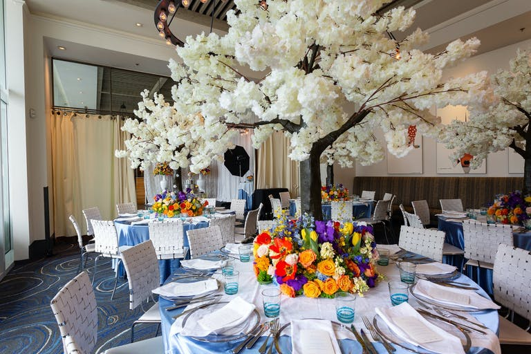 Baby Shower With White Flower Tree Top Centerpieces Surrounded By Colorful Floral Wreaths   PartySlate