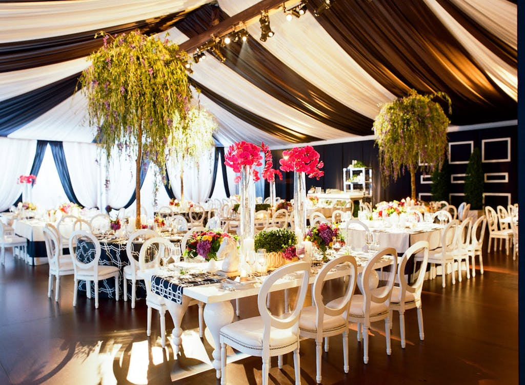 Frame Wedding Tent With Preppy Navy and White Striped Drapery | PartySlate