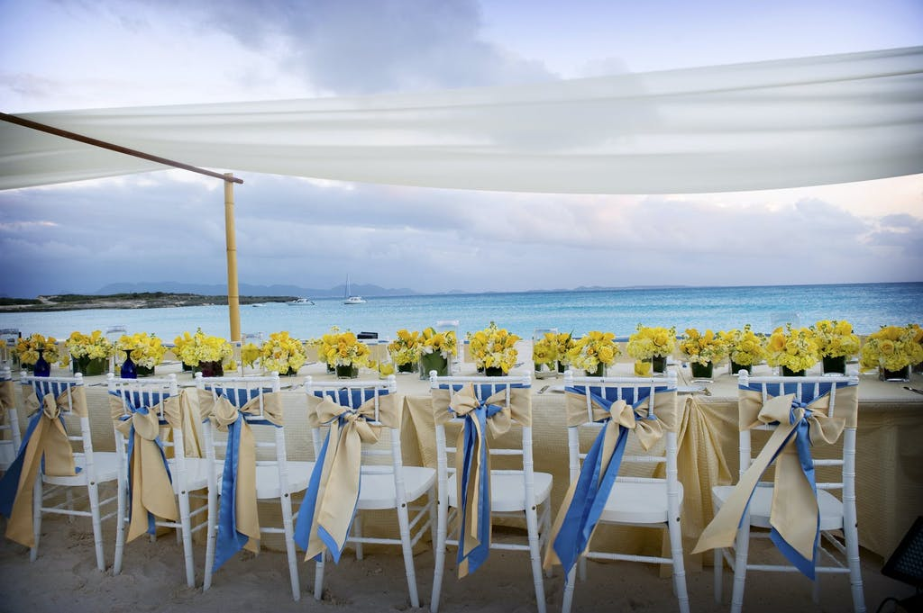 Beach Wedding With Reception Table Beneath Suspended Drapery | PartySlate