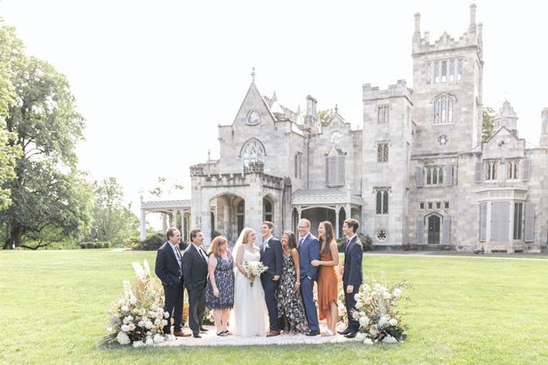 An image of a micro wedding right in front of a large castle venue   PartySlate