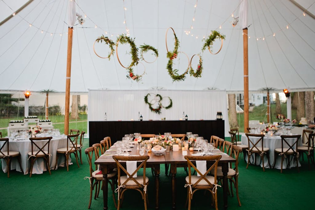 Canopy Sailcloth Wedding Tent With Rustic Greenery Ceiling Installation | PartySlate