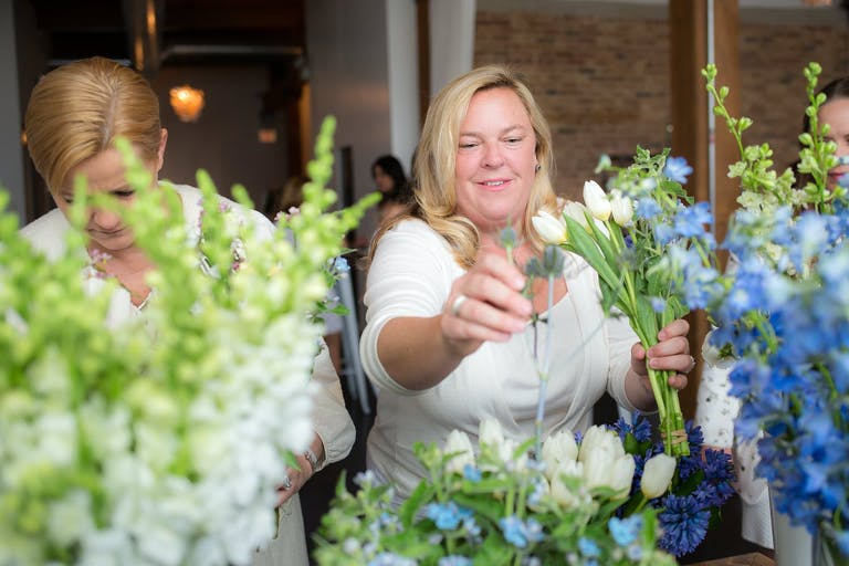 Two Women at Build Your Own Bouquet Station at Baby Shower   PartySlate