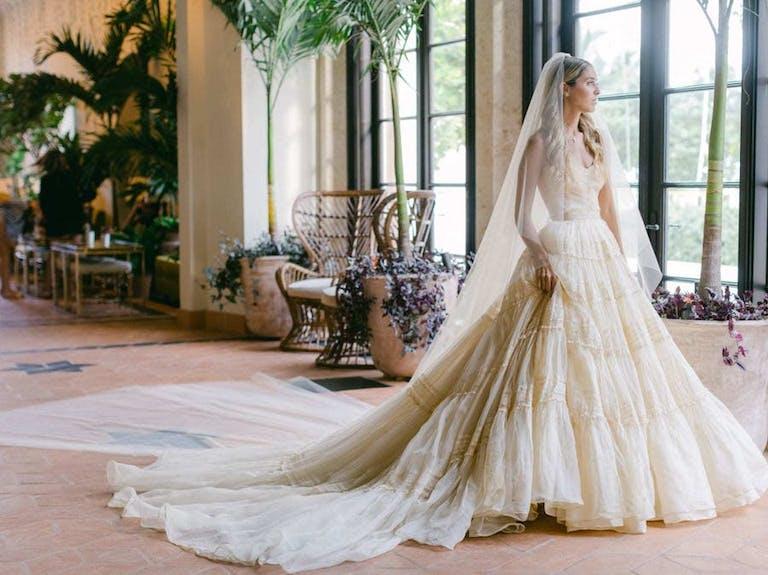 Beautiful cream wedding dress at a micro wedding   PartySlate