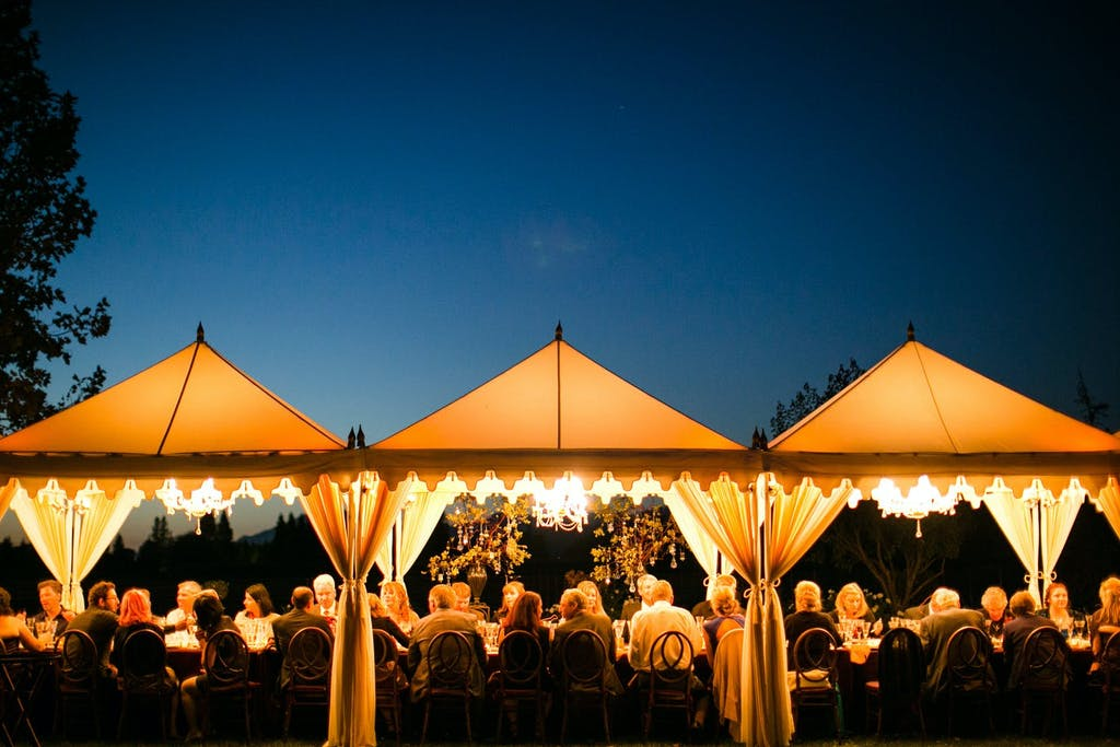 Three Connected Marquee Wedding Tents Illuminated at Night | PartySlate