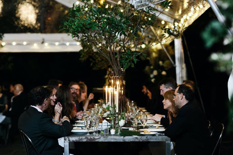 Rustic Tented Wedding With Greenery Centerpieces and Candlelight | PartySlate