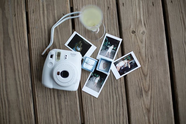 Polaroids used for unique wedding photos   PartySlate