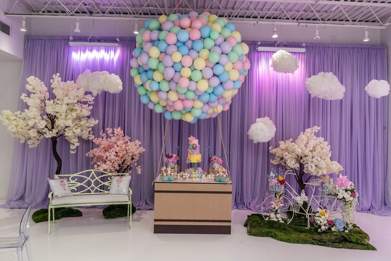 Hot Air Balloon-Themed Baby Shower with Violet Uplighting and Giant Hot Air Balloon Installation Made With Balloons   PartySlate