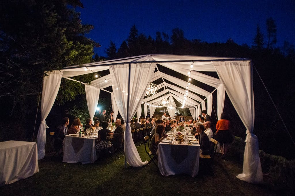 Open Wedding Tent With Illuminated White Drapery | PartySlate
