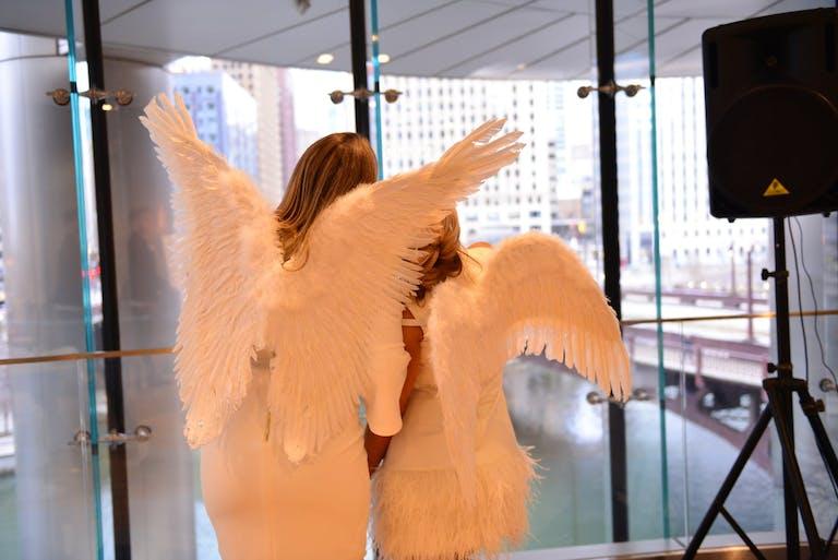 Two Women Wear Angel Wings at Baby Shower   PartySlate