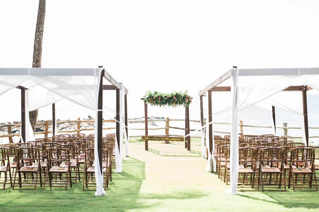 Wedding Ceremony in Hawaii With Two Rows of Cabana-Tented Seating | PartySlate