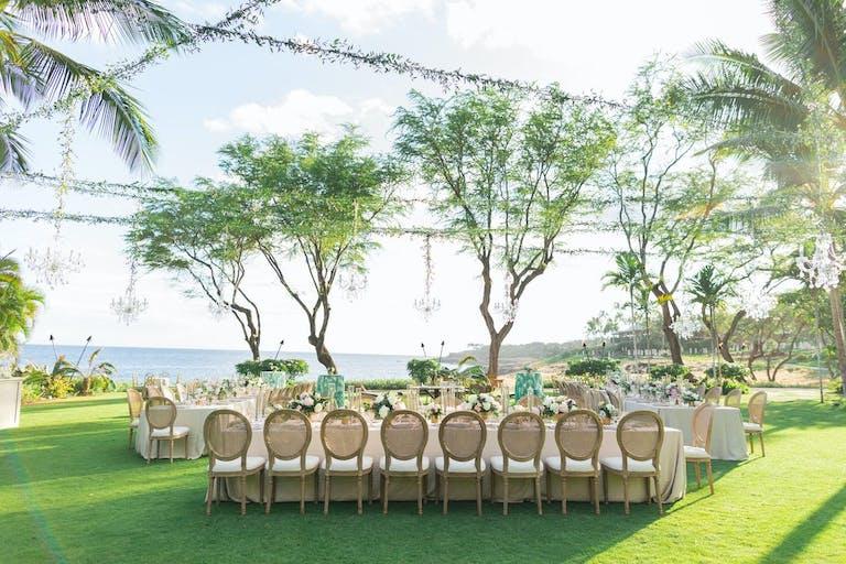 Hawaii beach wedding with beautiful greenery   PartySlate