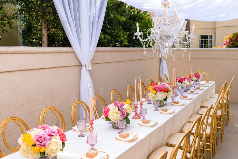 Princess-Themed Baby Shower With Colorful Flowers on Tablescape and Purple Drapery   PartySlate