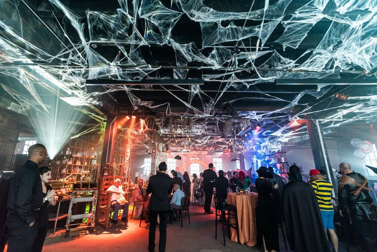 Halloween-Themed Baby Shower With Spiderweb Ceiling Installation   PartySlate