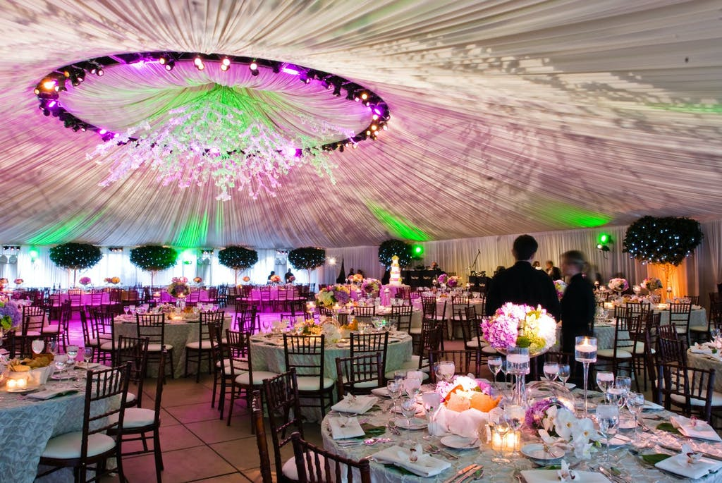Frame Tent Wedding With Technicolor Drapery | PartySlate