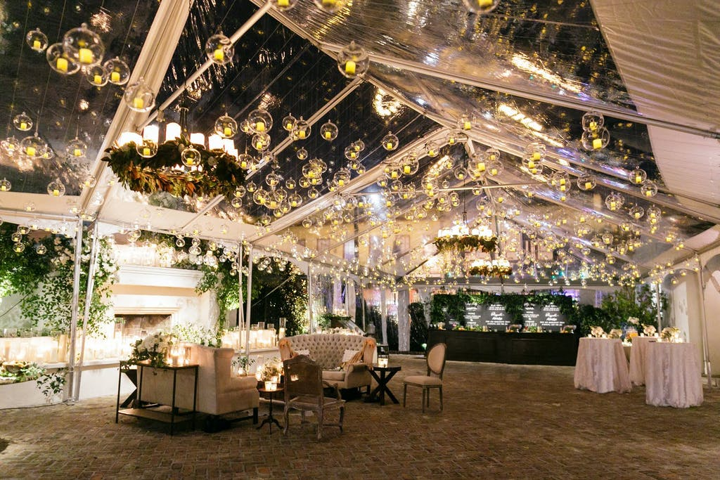 Clear Wedding Tented With Globed Lighting Ceiling Installation | PartySlate