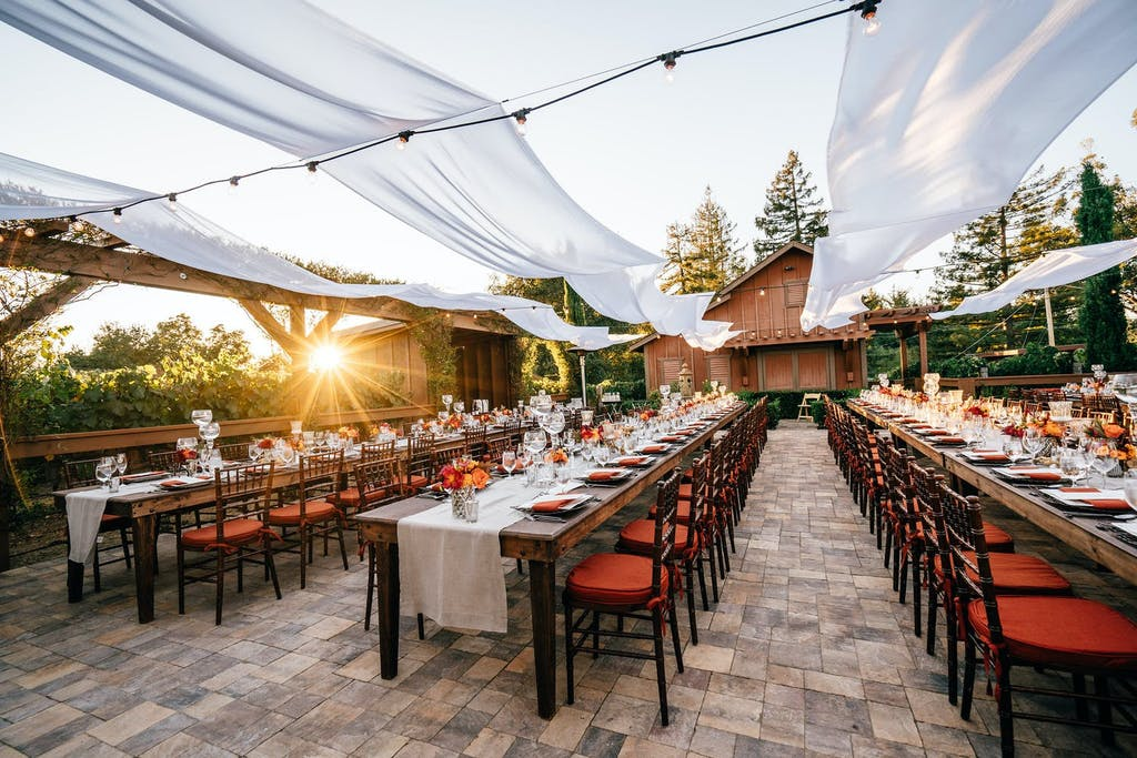 Cabana Style Structure With Open Roof of White Ribboned Drapery | PartySlate