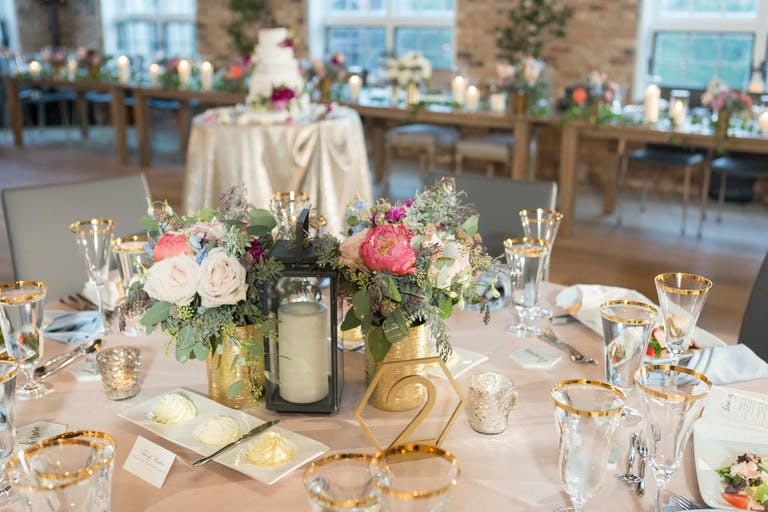 Rustic Wedding Centerpieces With Candlelit Lanterns and Colorful Flowers | PartySlate