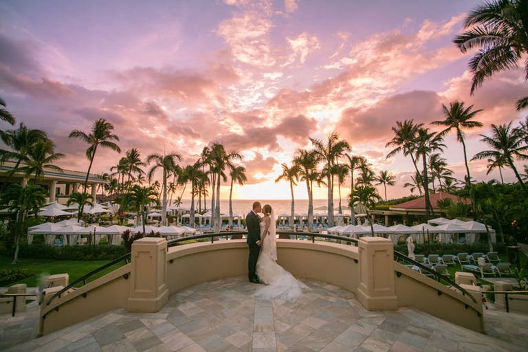 Pink Hawaii sky background for tropical wedding | PartySlate