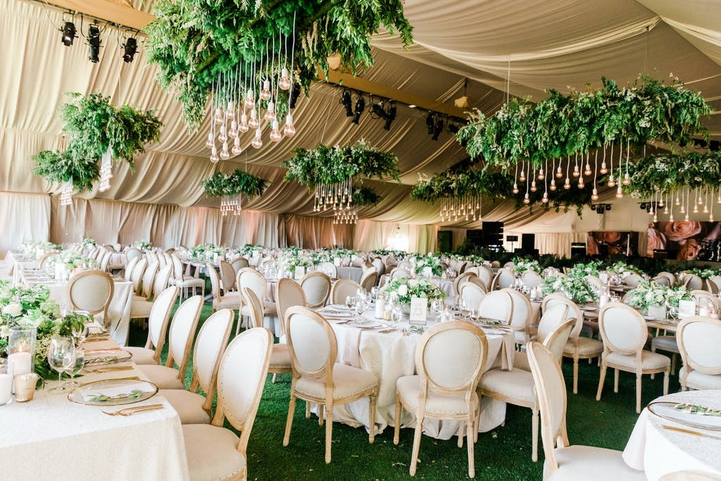 Golden Wedding Tent with Suspended Greenery | PartySlate