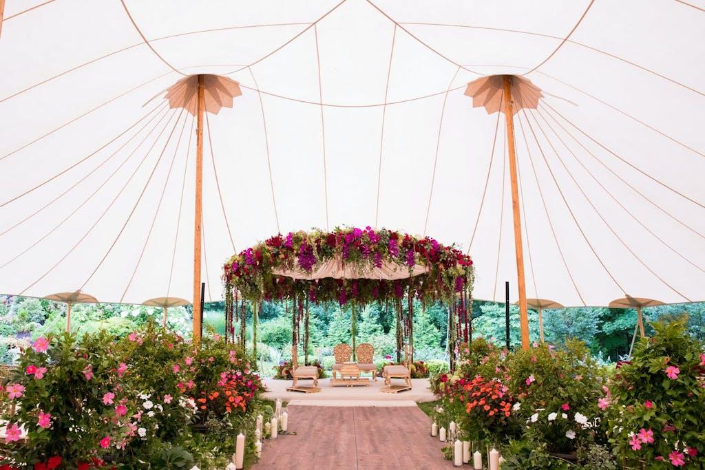 Sailcloth Wedding Tent with Pink Floral Mandap | PartySlate