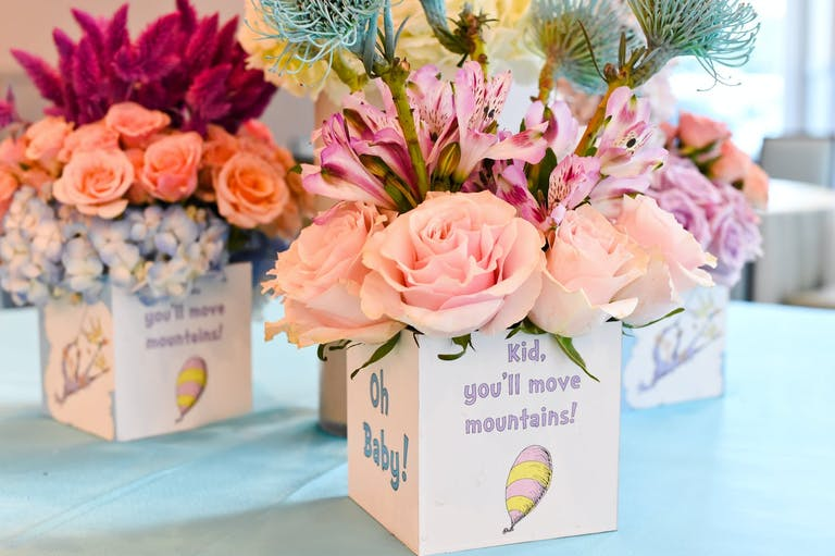 Dr. Seuss-Themed Baby Shower Centerpieces With Pink and Peach Flowers   PartySlate
