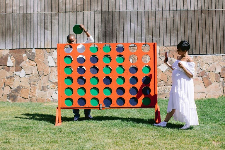 Outdoor Baby Shower With Giant Orange Connect Four Game   PartySlate