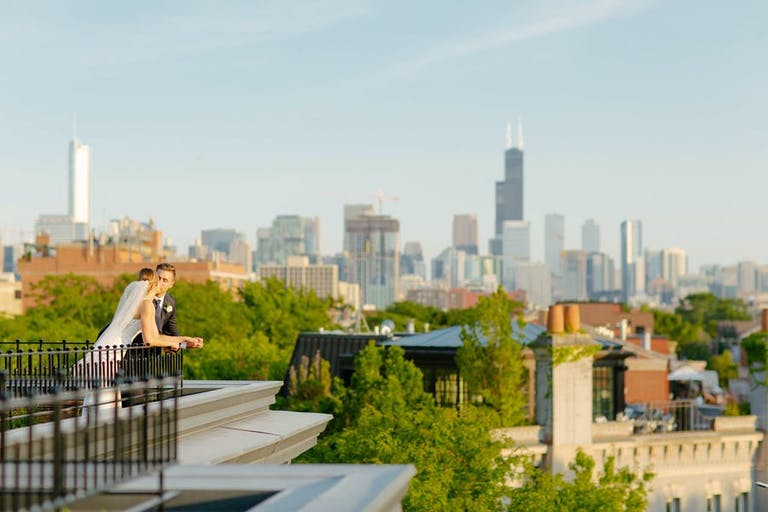 Intimate Summer rooftop micro wedding with Chicago skyline   PartySlate
