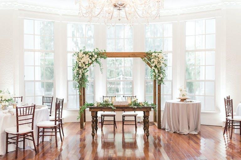 Rustic Wedding with Wooden Sweetheart Table and Wooden Arbor Backdrop | PartySlate