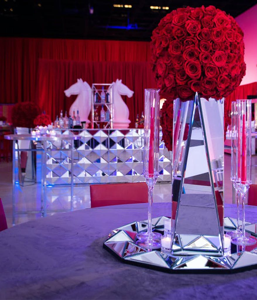Marie Antoniette themed baby shower with purple drapes and a pink cake