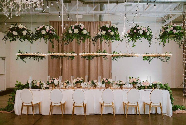 Garden themed micro wedding with so many hanging florals   PartySlate