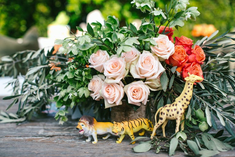 Baby Shower Centerpiece With Pink Roses and Safari Animal Figurines   PartySlate