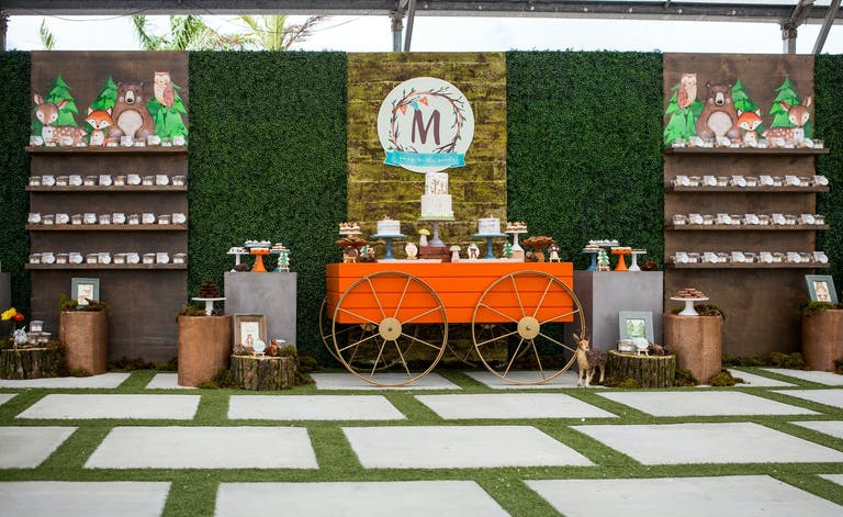 Forest-Themed Baby Shower With Boxwood Backdrop and Orange Wagon Dessert Station   PartySlate