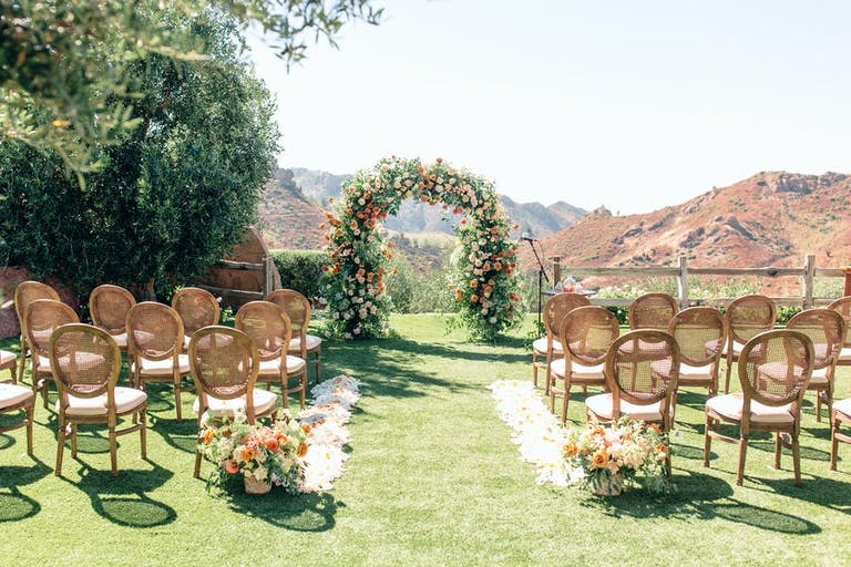 Mountain view micro wedding with a floral arch   PartySlate