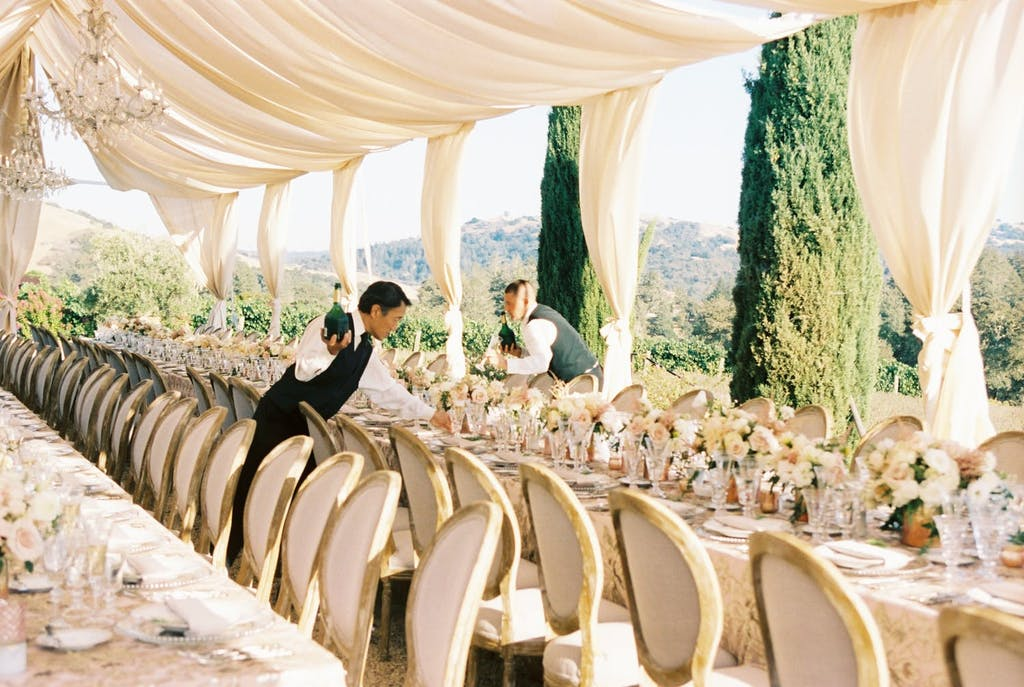Open Frame Wedding Tent With Cream-Colored Drapery in Sonoma Hills | PartySlate