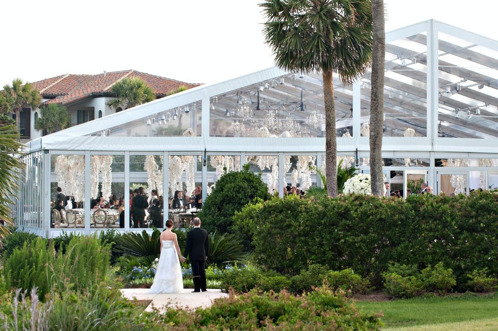 Clear Wedding Tent With White Flower Ceiling Installation | PartySlate