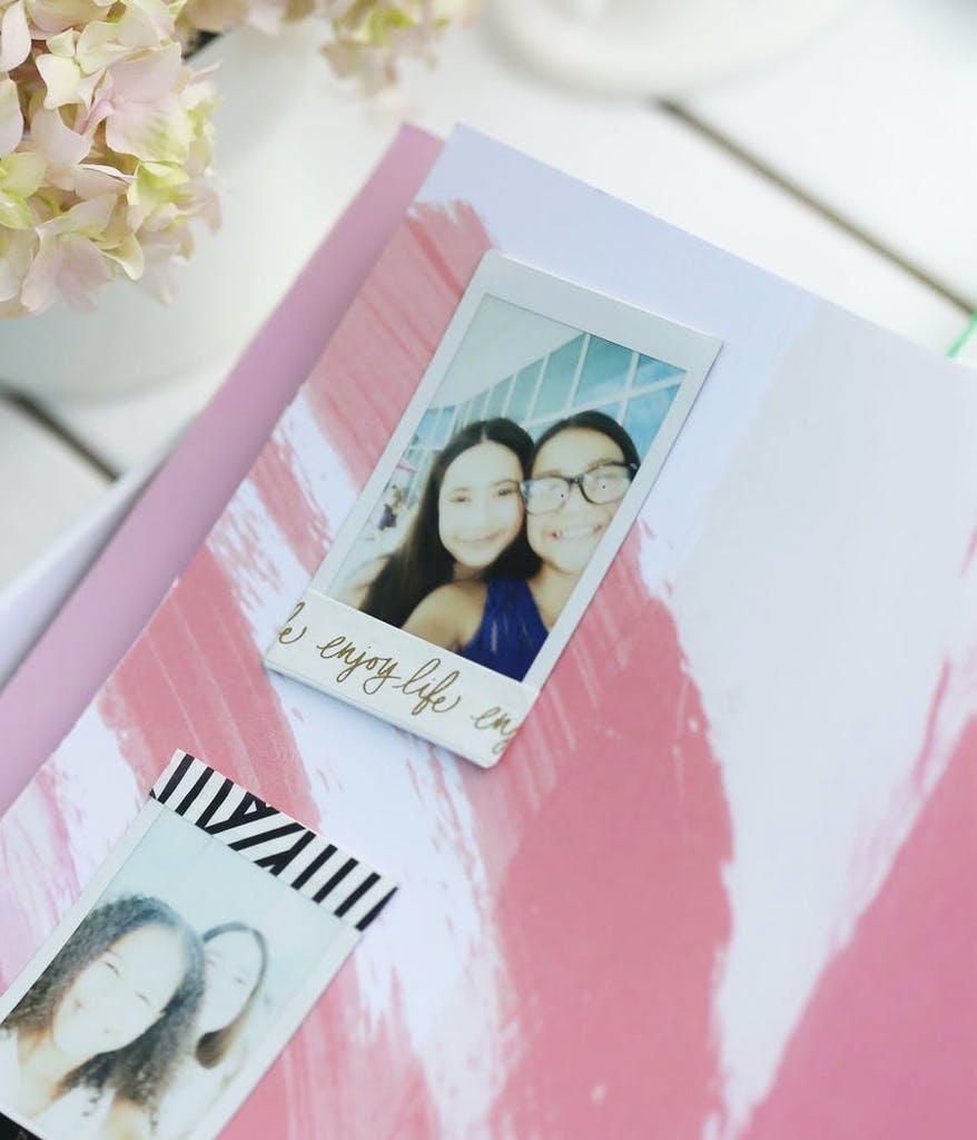Selfies on top of a pink book from a pink Bat Mitzvah