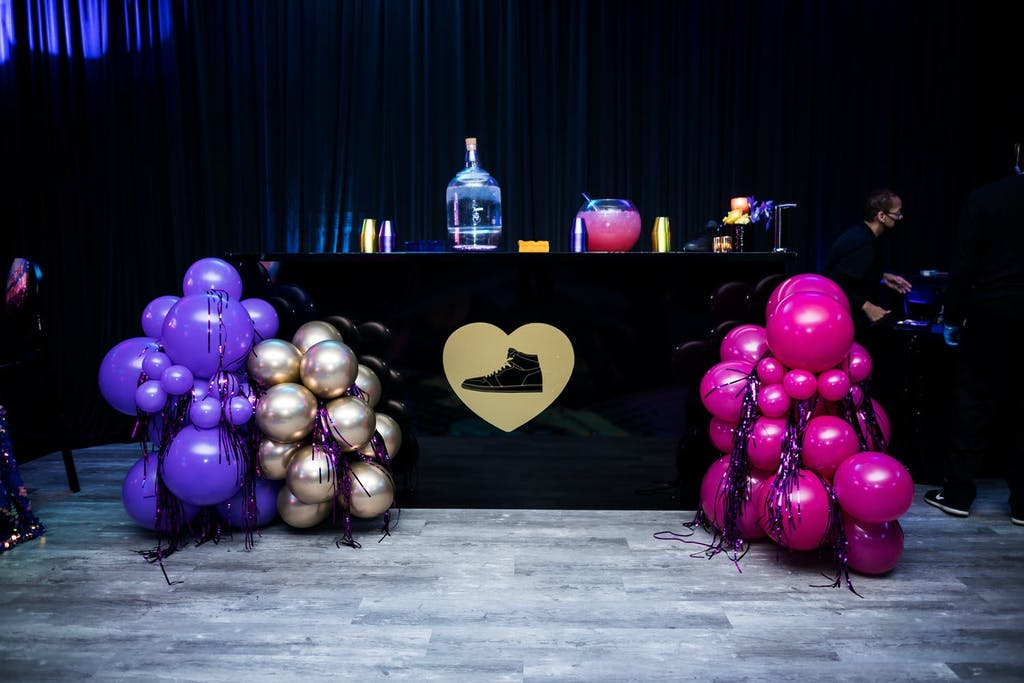 Sneaker-Themed Sweet 16 With Black Bar and Jewel-Toned Balloons | PartySlate