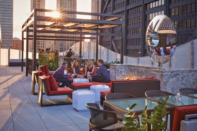 Friends Gather at The Rooftop at Torali at The Ritz-Carlton, Chicago at Sunset | PartySlate