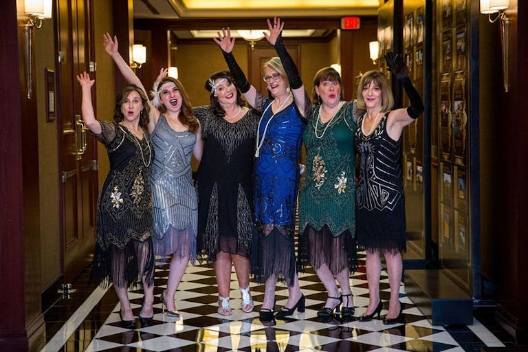 SIX GUESTS IN FLAPPER ATTIRE AT IMPACT MELANOMA'S SHADES OF HOPE GALA 2019 AT THE COLONNADE IN BOSTON, MASSACHUSETTS | PARTYSLATE